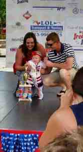 Madelyn Moodie, with parents Rachell and Matt Moodie,  was the Little Miss Firecracker overall girls winner.  (Photo provided)