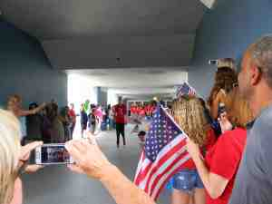 Team member Samantha Frahm leads the way as the Land O' Lakes High School Special Olympics Unified Soccer team is given a patriotic send-off to the 2015 Special Olympics World Games in Los Angeles.
