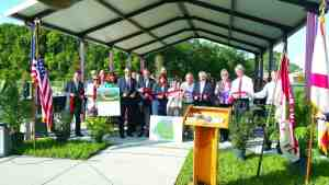 Dignitaries and park supporters gathered for a ribbon cutting to mark the completion of a $2.3 million project to improve Land O' Lakes Community Park. (Courtesy of Teri Dusek)