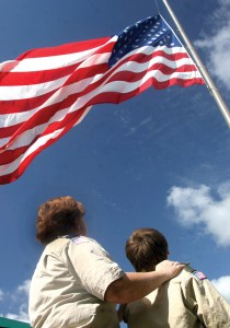 Meagan Sammons of Zephyrhills and her son, Heath Sammons, 11, a Boys Scout with Troop 2 watched the American flag billowing in the wind as it flew at half-staff to honor those who died on 9/11.