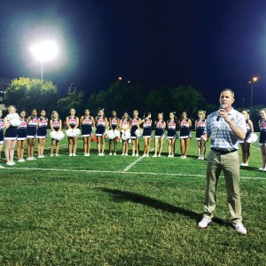 Head of School Ryan Kelly announced the $1 million matching donation at halftime of the school's Aug. 28 football game. (Courtesy of Carrollwood Day School)