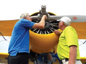 Greg Lasher of Leechburg, Pennsylvania, left, and Lenny Carver of Sidney, Montana inspect the radial engine of a vintage PT-17 Stearman. (Steve Hollingshead/Photos)
