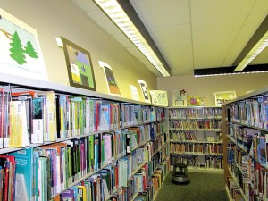 Student artwork is displayed above the bookshelves in the Saint Anthony Art Show at the Hugh Embry Branch Library in Dade City. (Courtesy of LInda Whitman)