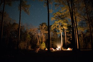 Expedition members set up camp along the Apalachicola River, under a clear, star-studded night.