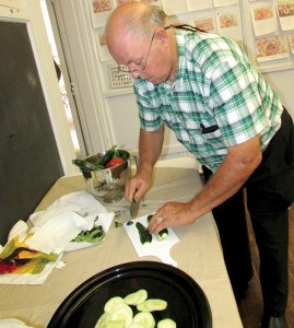 Jim Dennison slices up a platter of fresh veggies for the descendants' day feast at the Old Lutz Schoolhouse. (B.C. Manion/Staff Photos)