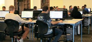 Students are busy during a cybersecurity class at Saint Leo University. The field of cybersecurity requires technical skills, but is both financially and professionally rewarding, said Dr. Vyas Krishnan, of Saint Leo University. (B.C. Manion/Staff Photo)
