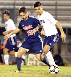 Dean LaGattuta, wearing No. 25, competes in a soccer game against Wharton High School.