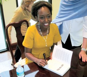 Immaculee Ilibagiza signs copies of her book, 'Left to Tell: Discovering God Amidst the Rwandan Holocaust.' (B.C. Manion/Staff Photo)