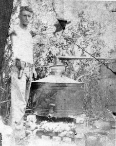 Around 1931, 19-year-old Lonnie Tucker watches for revenuers. He is pictured in Wesley Chapel with his moonshine still.