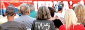 It was easy to see that biggest fan of Taylor Hicks in this row of audience members. Karen Twilla, center, of Land O' Lakes, is flanked by Fred Twilla, her husband, left, and Kelli Actis, right, of Tampa, as they wait for the show to start at the Land O' Lakes Spring Music Festival & Expo, presented by the Central Pasco Chamber of Commerce. Karen Twilla said she has seen Hicks perform in Las Vegas, in the Broadway production of Grease, and in Tampa. She was looking forward to adding Land O' Lakes to that list.