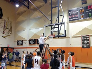 Zephyrhills basketball coach Alan Reed cuts down the nets after the Bulldogs advanced to the state tournament for the first time in 50 years. (Courtesy of Zephyrhills High School)