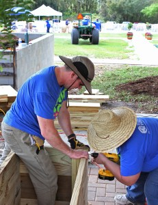 Brett Uravich, left, Florida Hospital Zephyrhills' liaison for physicians and business development, and Kim Friedmeyer, clinical nurse educator, put together raised garden beds at the hospital's community garden.
