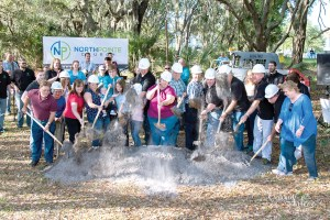 Members of North Pointe Church enthusiastically toss dirt during a groundbreaking ceremony for the church's first permanent home. (Photos courtesy of Northpointe Church)