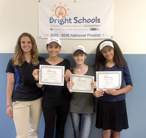 Sarah Szymanski, a teacher at Pine View Middle School, left, coached Grace Nobles, Catie Tomasello and Sophia Nobles in the Bright Schools Competition. The team finished second in a competition that included students from across the U.S. and Canada. (Courtesy of Heather Tomasello)