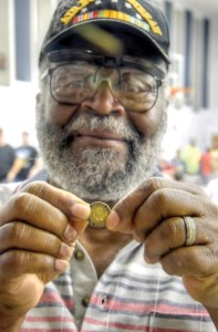 Veteran Air Force Sgt. Robin McIntosh, of Zephyrhills, shows off the lapel pin acknowledging service during the Vietnam War. (Photos courtesy of Richard K. Riley)