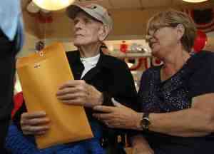Veteran resident, Leo Rodgers, 94, of Port Richey, clutches an envelope of mail he received during mail call. His daughter, Sue Williams, of Homosassa, was at the event, too.
