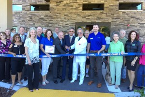 Pat Boone, center, joins the Central Pasco Chamber of Commerce, in a ribbon-cutting ceremony at Angels Senior Living at Lodges of Idlewild.