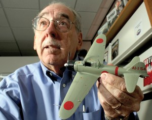 Davis Gandees is a history buff on World War II and builds model replicas of fighter planes used at Pearl Harbor. A display by Gandees at the Lutz Branch Library honors the 75th anniversary of the Dec. 7 attack on Pearl Harbor.
