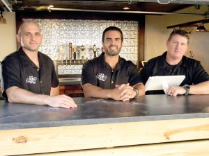 Beer-brewing friends Mark Pizzurro, left, Peter Abreut and Joe Traina have opened In the Loop Brewing at 3338 Land O' Lakes Blvd.