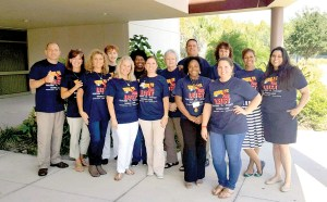 Steinbrenner faculty members show their support for Mike Leist by wearing 'Kick it for Leist' T-shirts. Leist is a history teacher, who's battling ALS. (Courtesy of Steinbrenner High School)