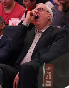 Apr 5, 2015; New York, NY, USA; New York Knicks general manager Phil Jackson yawns against the Philadelphia 76ers during the second half at Madison Square Garden. The Knicks defeated the 76ers 101 - 91. Mandatory Credit: Adam Hunger-USA TODAY Sports