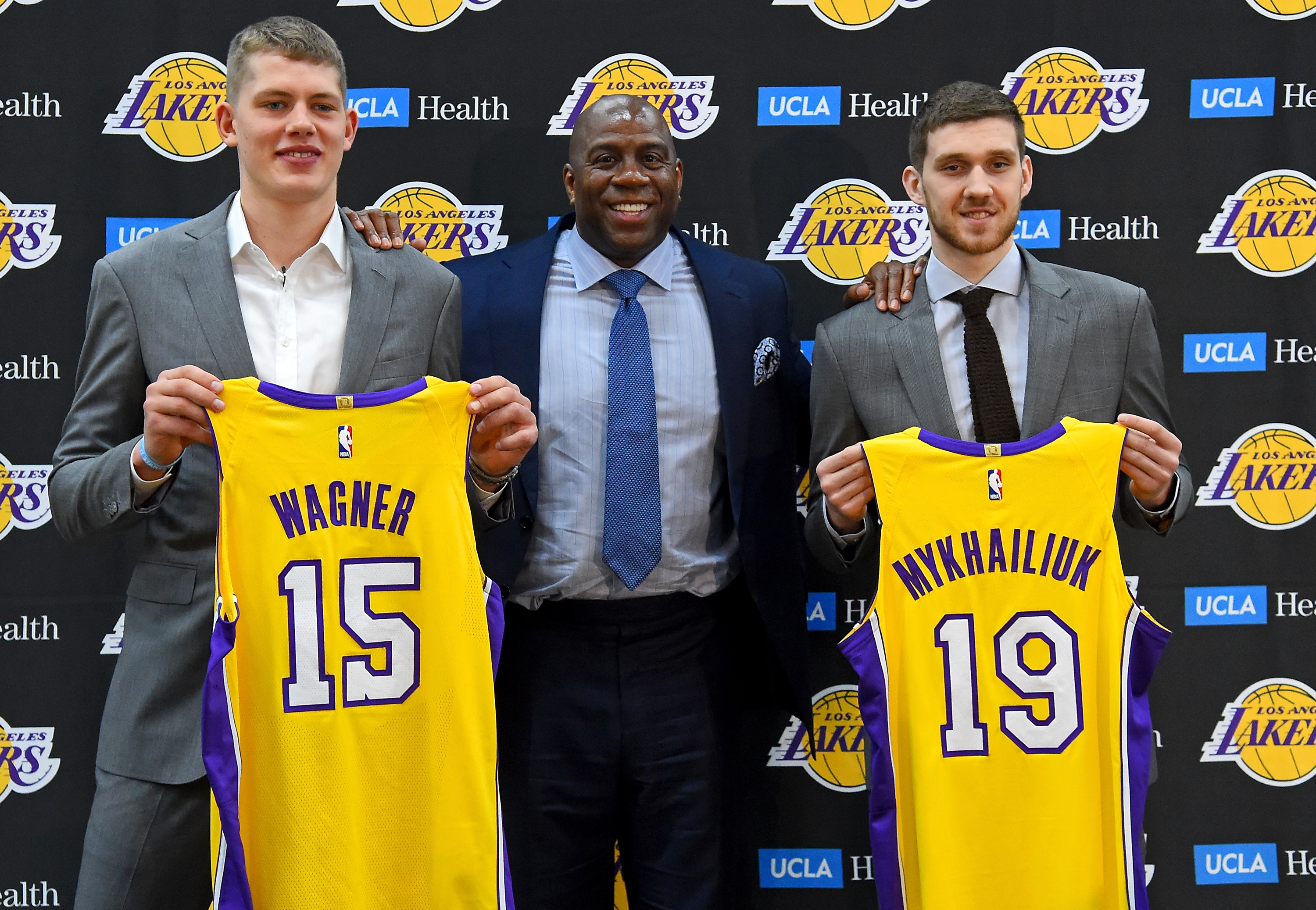 359a9ee7f4e EL SEGUNDO, CA – JUNE 26: Magic Johnson, the Los Angeles Lakers president  of basketball operations, stands with the team's 2018 NBA draft picks Moritz  ...