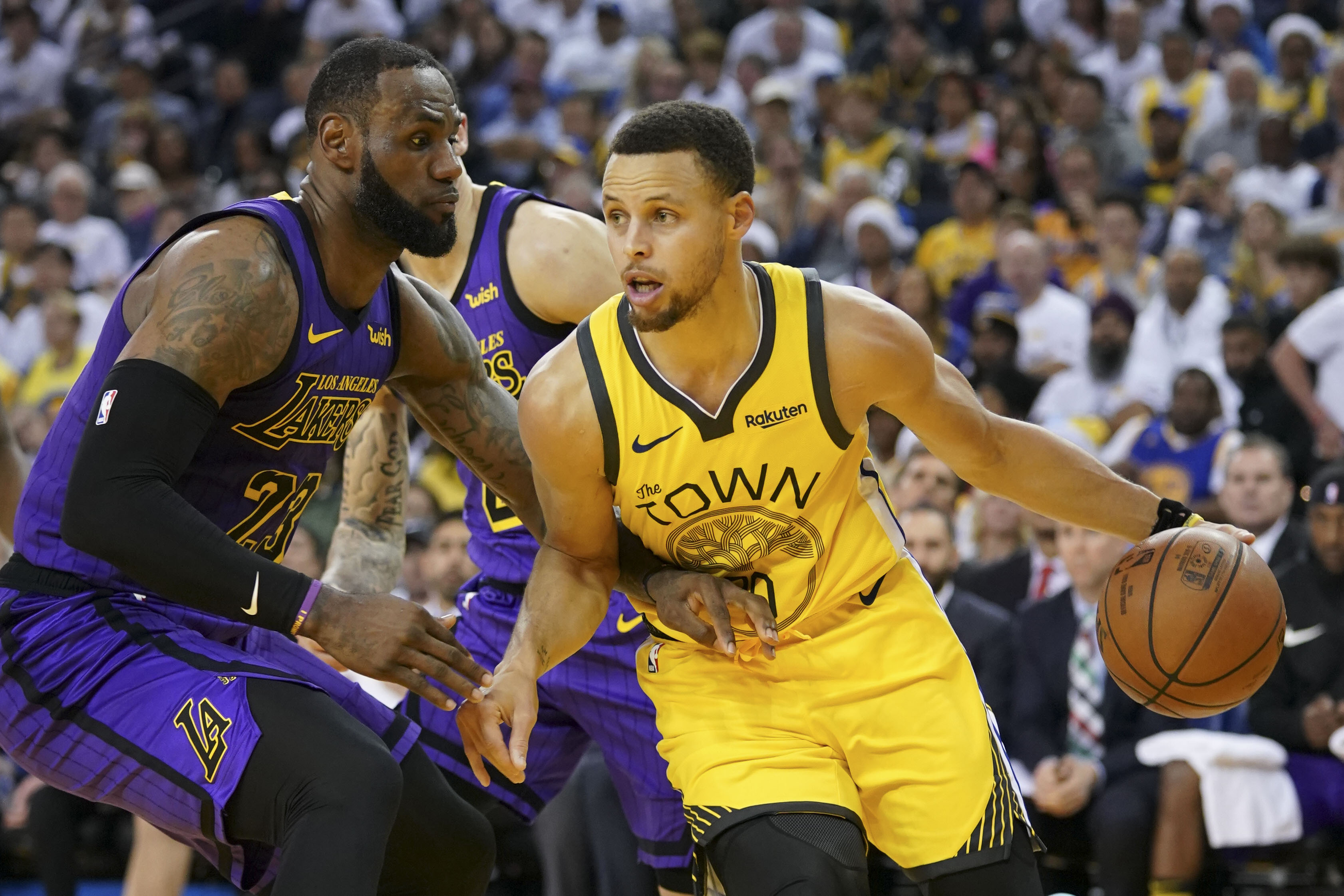 57b93210b32 ... Warriors guard Stephen Curry (30) dribbles the basketball against Los  Angeles Lakers forward LeBron James (23) during the third quarter at Oracle  Arena.
