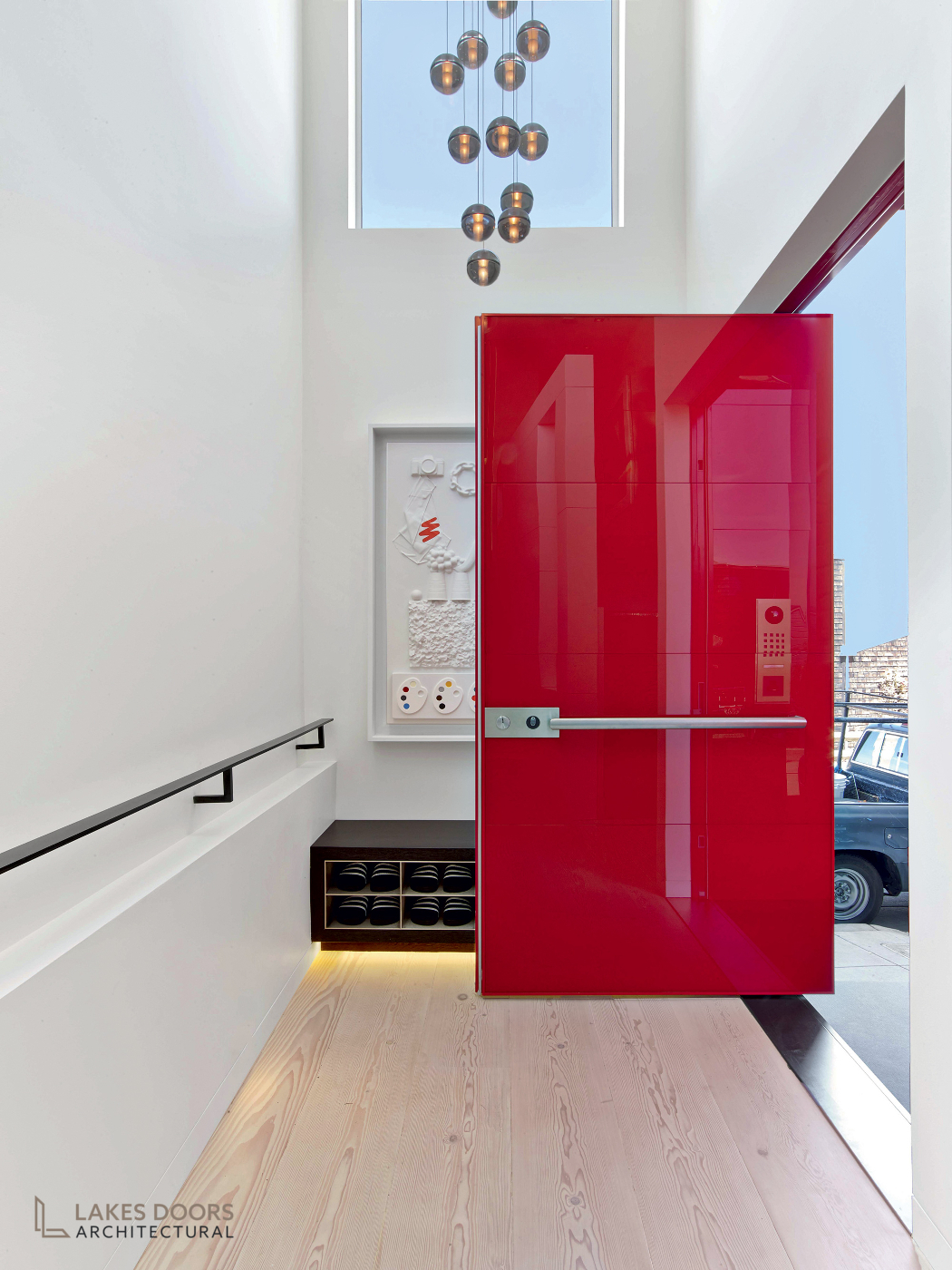 Oikos Pivot Door Red Glass