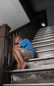 child huddled on step