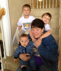 diane sitting on steps with three kids