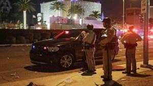 Policemen in Las Vegas speaking to people in a car