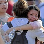 a photo of two girls embracing each other, crying.