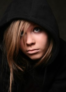 Teen in dark hoodie