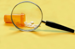 magnifying glass over pills