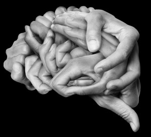 A human brain made with hands, different hands are wrapped together to form a brain