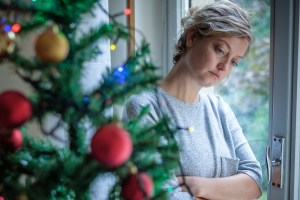 Woman feeling alone and sad during christmas holiday