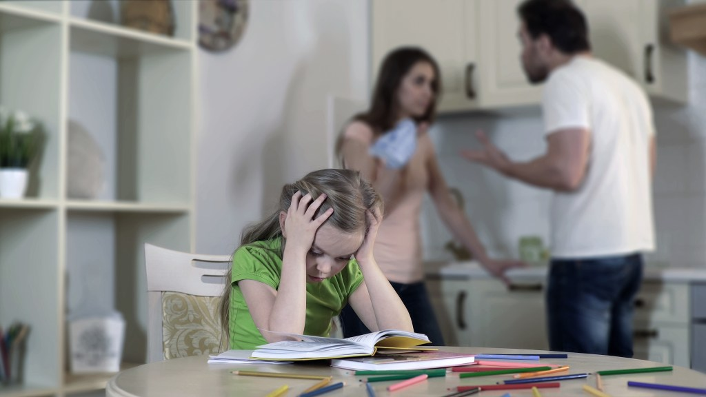 Upset child listening to parents fight,  conflict in family