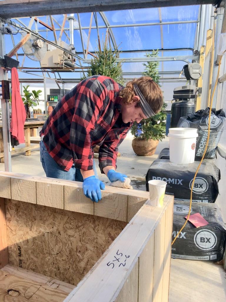 student sanding display