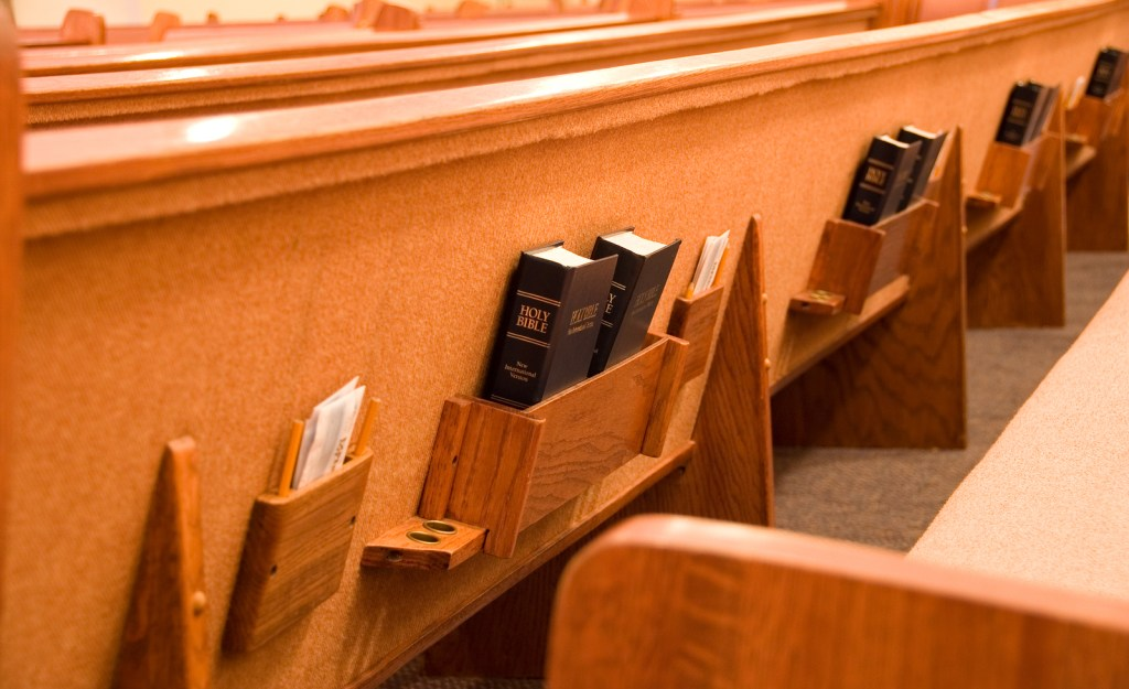 Holy Bible in the back of a pew in a sanctuary