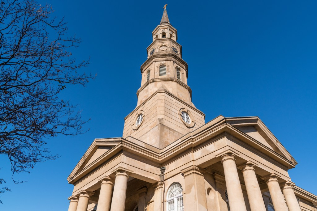 Steeple of historic St Phillip's Church along Church Street in Charleston, SC