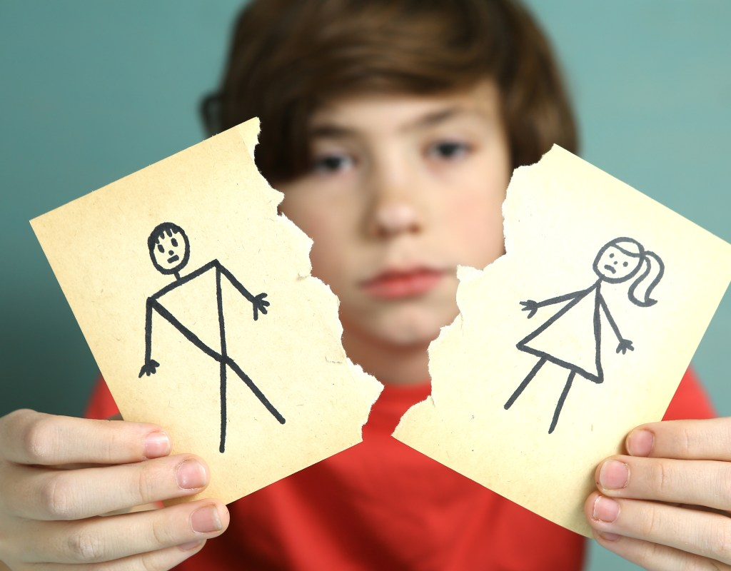 sad boy unhappy about parents, man and woman paper drawing torn apart