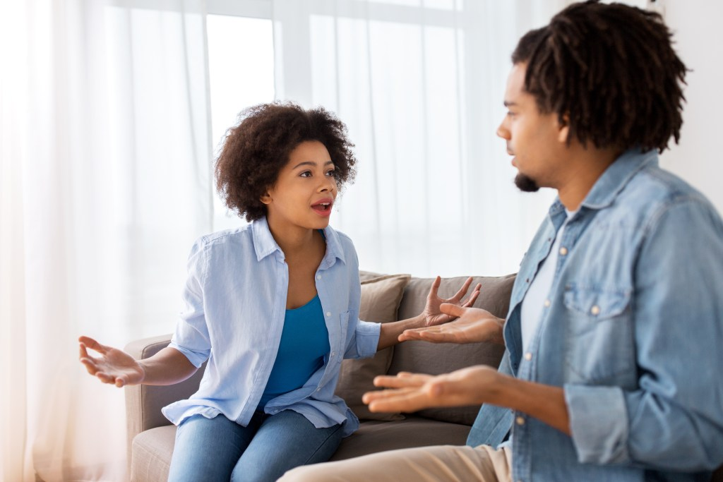 relationship difficulties, conflict. unhappy couple having argument at home