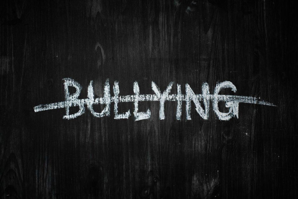 Bullying word crossed out on a blackboard