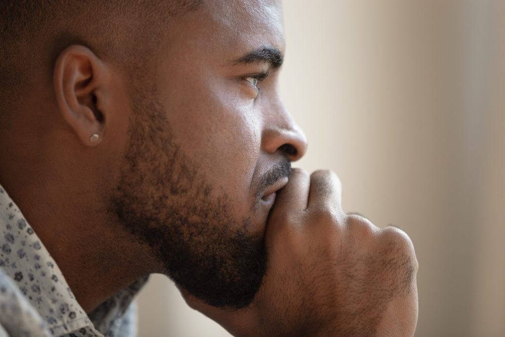 Close up of pensive biracial man thinking having problem