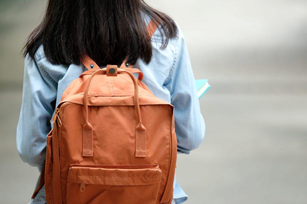 Back of girl carry school bag