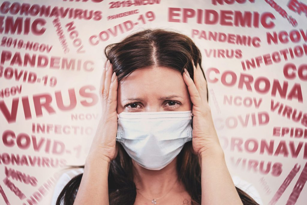 a woman with a mask on scared by the news of the coronavirus covid-2019.