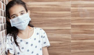 PTSD or post-traumatic stress disorder after coronavirus pandemic - Young girl with mask  looking sad, fearful, or anxious