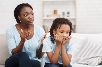 Family Conflict. Quarrel between black mother and daughter at home, sulky child ignoring her mom