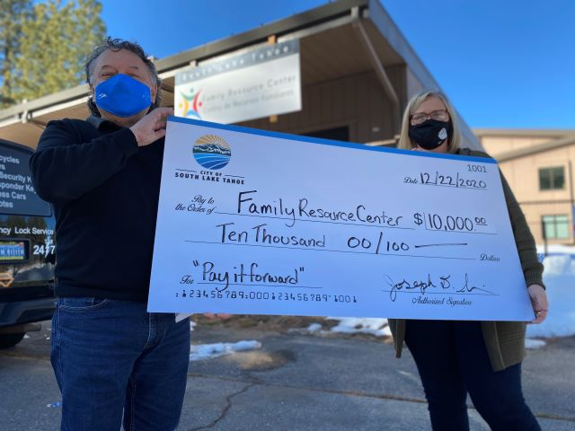 Mayor Wallace, City Present Family Resource Center with $10,000 for 'Pay It Forward' Program