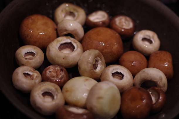 Brown and White Mushrooms Sauteed in a Pan
